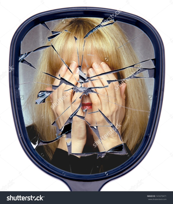 stock-photo-a-woman-covers-her-face-reflected-in-a-broken-mirror-or-the-shattered-life-concept-141673471